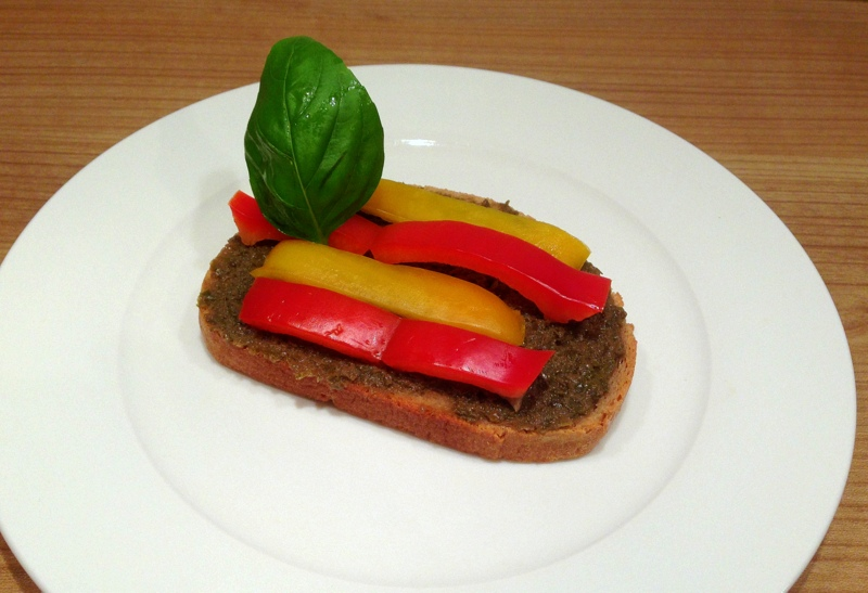 Bruschetta with capres, pepper fruit and basil