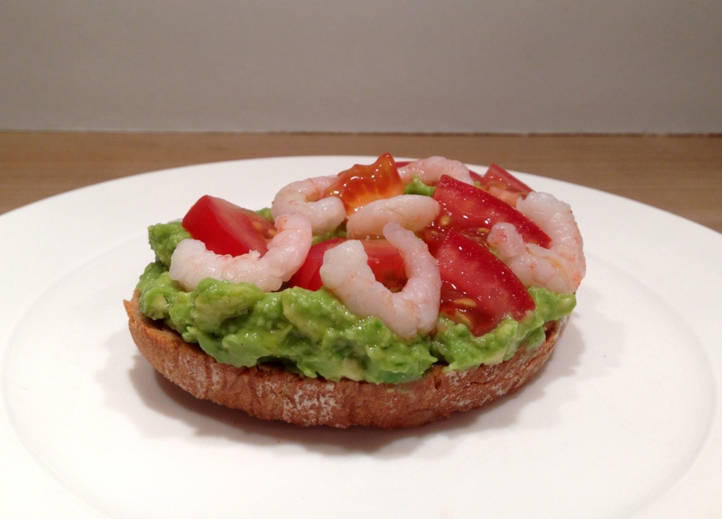 Bruschetta with avocado, tomatoes and shrimps